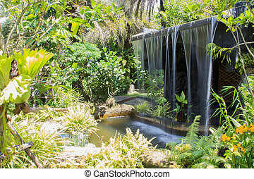 the man made waterfall in the botanical garden
