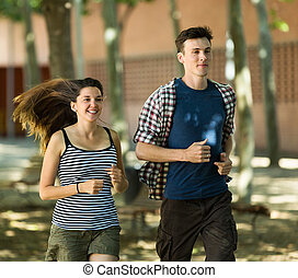 Active young people running outdoor at summer day