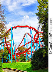 Roller Coaster in amusement park. - Roller Coaster in funny...