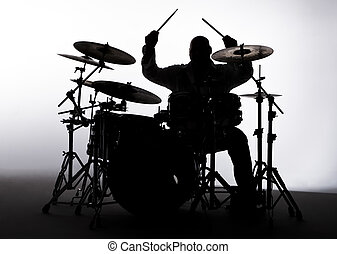 Silouette of a Drummer - Siloutte of a male drummer in the...