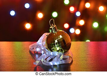 golden chistmas ball serpentine - golden chistmas ball with...