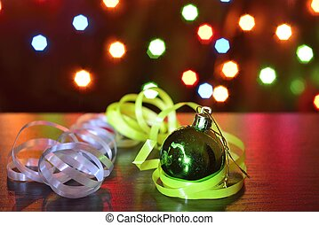 green chistmas ball with white serpentine