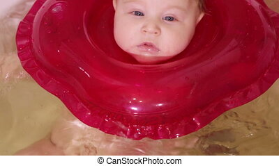 Child turns in bathroom - Baby swimming circle swims in...