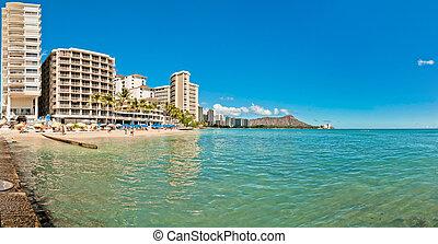 Waikiki shoreline with tourists in Honolulu, Hawaii