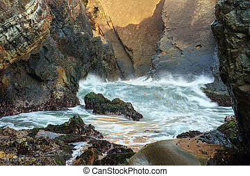 Waves at Sugarloaf Point Sea Chasm Cave - One of the smaller...