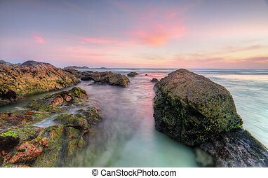 Sugarloaf Point Rocks at sunset - Lots of varying colours in...