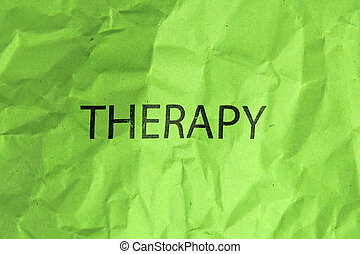 word therapy on crumpled green paper