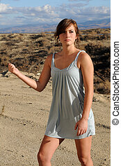 Hitchhiker - Pretty brunette in a short dress hitchhiking in...