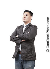 face of young asian man wearing western suit standing and...