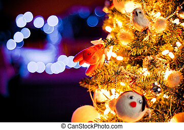 decorated Christmas tree with de-focused lights background