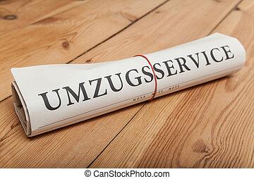"""""""umzugsservice"""" german newspaper on wooden floor"""