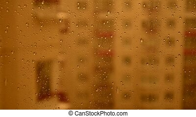 Heavy rain outside the window. Rain dripping on the glass