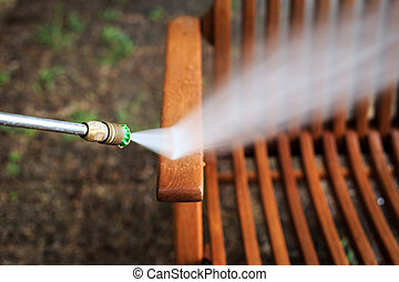 Wooden chair cleaning with high pressure water jet