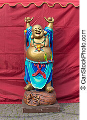 buddha sculpture - smiling buddha figure with hands up