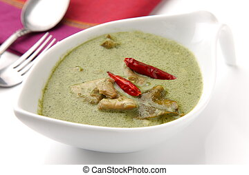 Thai green chicken curry - studio shot of Thai green chicken...