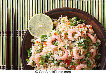 fried rice with shrimp and vegetables close-up, horizontal...