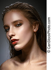 Hot young woman model with sexy bright red lips makeup, strong e