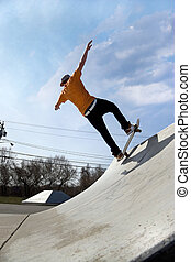 Skateboarder at the Skate Park - Portrait of a young...