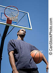 Basketball Player Thinking - Young African American man...