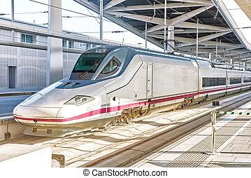 Modern high speed train at the railways stantion. - Modern...