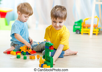 children playing in the room - children boys playing in...