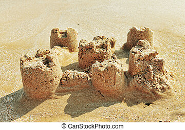Destroyed sand castle on a beach. Spain