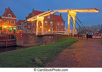 Medieval bridge and houses in the village Enkhuizen The...