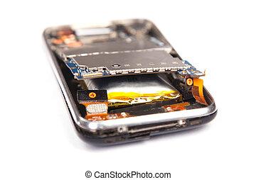 Smashed mobile phone isolated on white background
