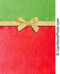 Gold ribbon on green and red leather for Christmas...