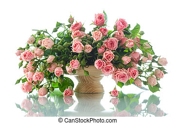 pink roses - beautiful bouquet of pink roses on a white...