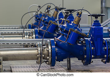 Water pumping station with booster pump control valves