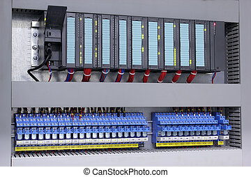 Programmable logic controller and relays in industry