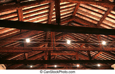 the roof with beams facing bricks and halogen lamps