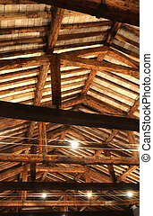 roof with beams facing bricks and halogen lamps