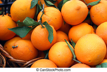 juicy oranges full of vitamin C for sale at the market -...