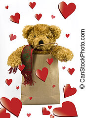 Valentines teddy bear in shopping bag on isolated background