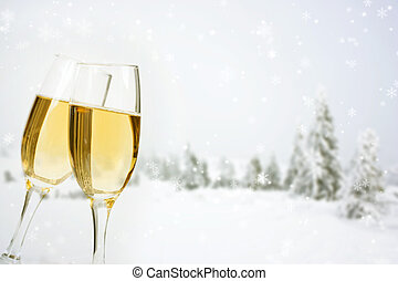 Glasses with champagne on winter background - Glasses with...