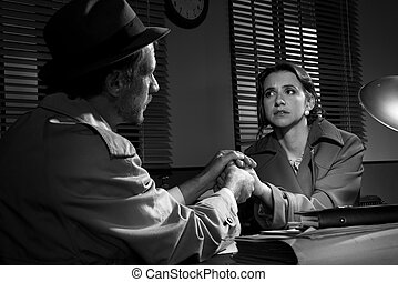 Handsome detective comforting a young scared woman -...