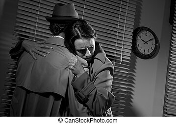 Man consoling a young woman in his office - Detective...