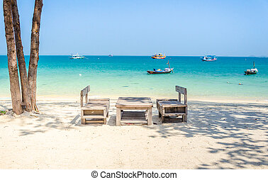 Empty wooden table on the beach - Koh samed, Rayong thailand