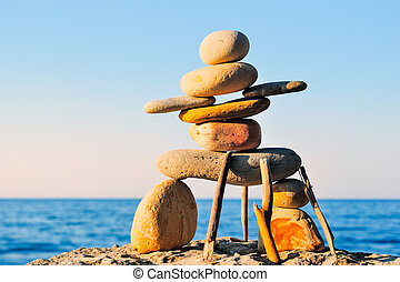 Inukshuk - Figure of inukshuk on the seacoast