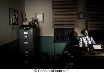 Reporter working late at night - 1950s style reporter...