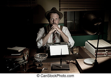 1950s journalist working late at night in his office typing...