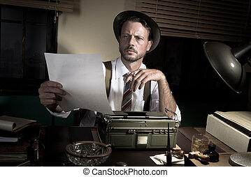Professional reporter proofreading his text - 1950s reporter...