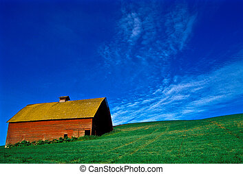 old barn - an old red barn on a green field