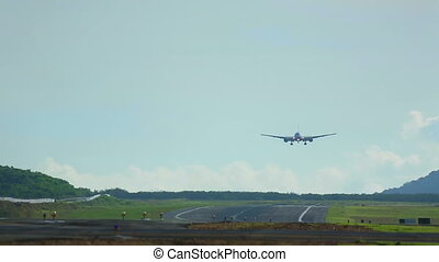 Touch down - Widebody jet airplane touch down the runway,...