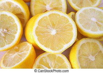 Lemons - frame full of sliced lemons with the main focus...