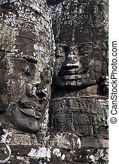 Gigantic face statues at Khmer temple- Angkor Wat ruins,...