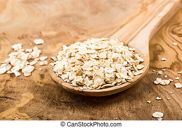 oatmeal - Oats on a wooden spoon