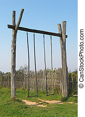 Seesaw - photo seesaw residing in rustic courtyard
